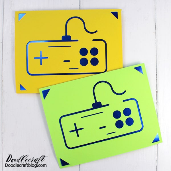 """Search Cricut Design Space for """"insert card"""" and you'll find blank cards with these little corner notches. Then search for video game controller and upload this one. This image is perfect because it's not a complete image, it's more of a stencil.  Then place them together and slice the images or attach them. Then score and cut. Remove paper from the mat and then insert some metallic poster board into the notches."""
