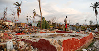 A Haitian man stands next to the foundation of his former house Sunday in a seaside fishing neighborhood in Port Salut almost destroyed by Hurricane Matthew. (Photo Credit: AP Images) Click to Enlarge.