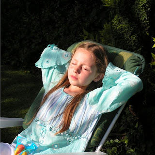 Child relaxing in the garden