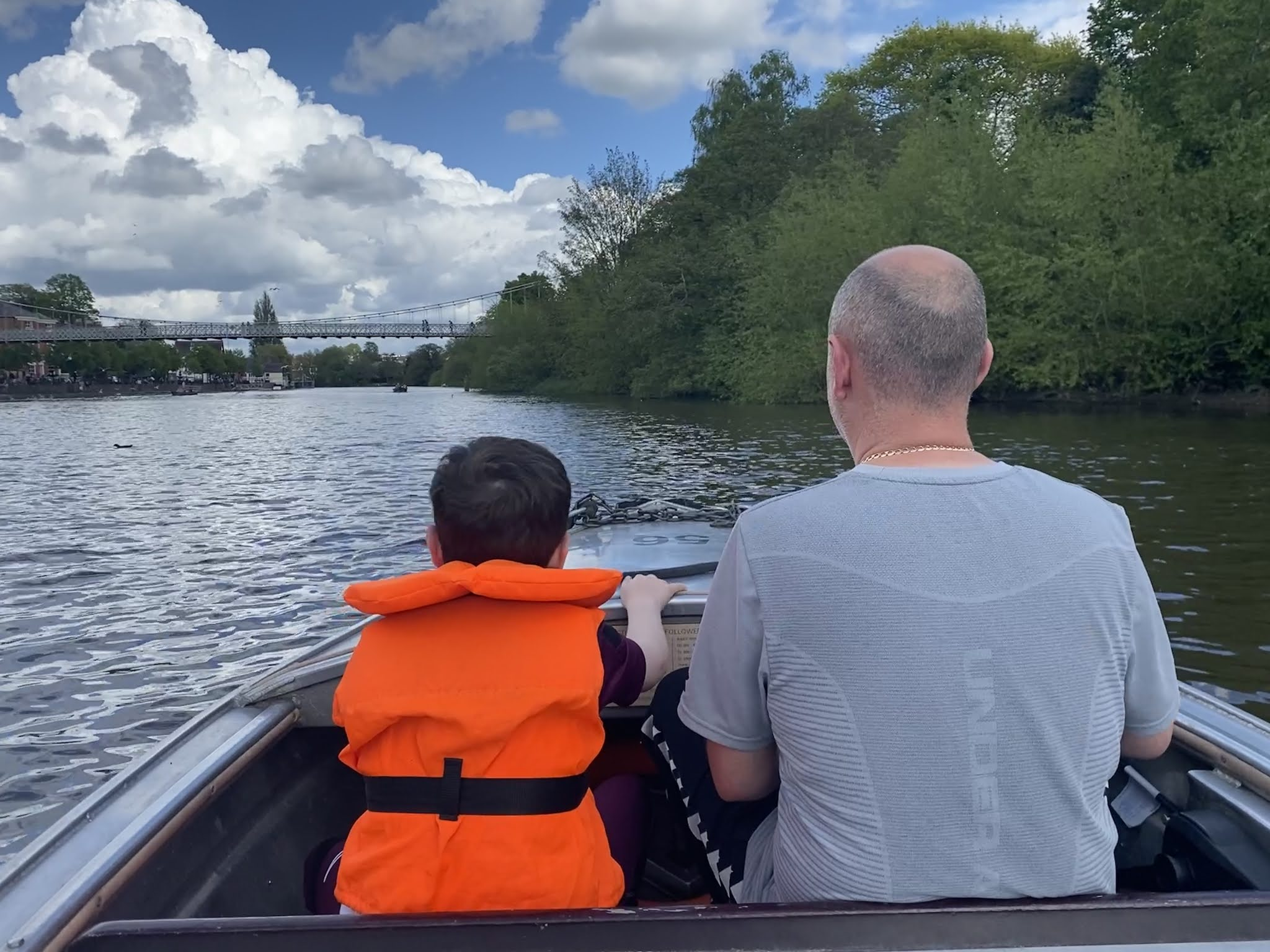 man and boy on motor boat