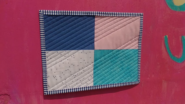 Pieced mini quilt back
