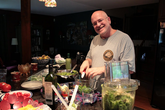 "Pete ""sings"" in the kitchen too! Making pesto."