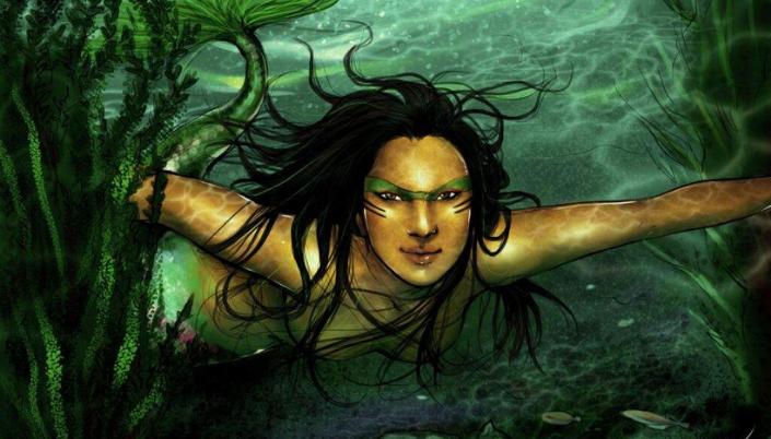 Imagem: a figura de uma mulher indígena com o rosto com listras pintadas, cabelos negros e longos, nadando debaixo da superfície de um rio, a cauda de peixe e folhas de plantas aquáticas flutuando ao redor.