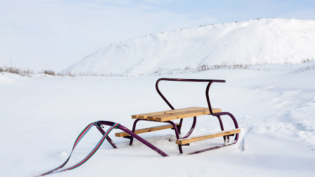 a wood and metal sled waiting for a rider