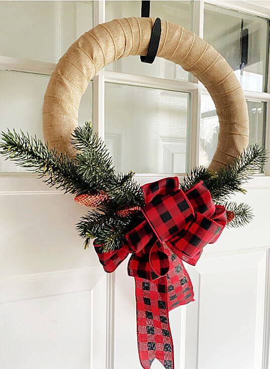 Ribbon wreath with greenery on front door