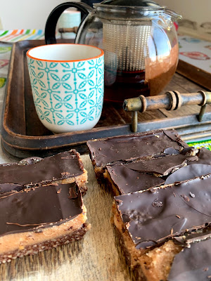 Teapot, mug and vegan snickers bars