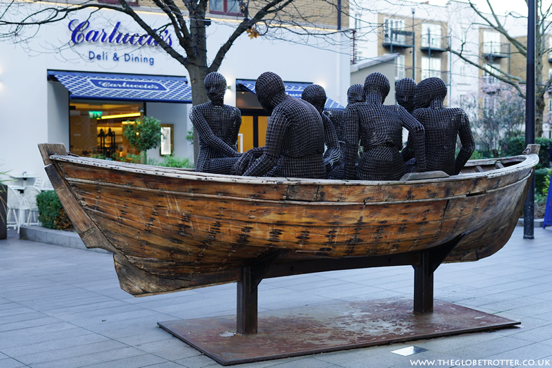 Wooden Boat with Seven People by Kalliopi Lemos