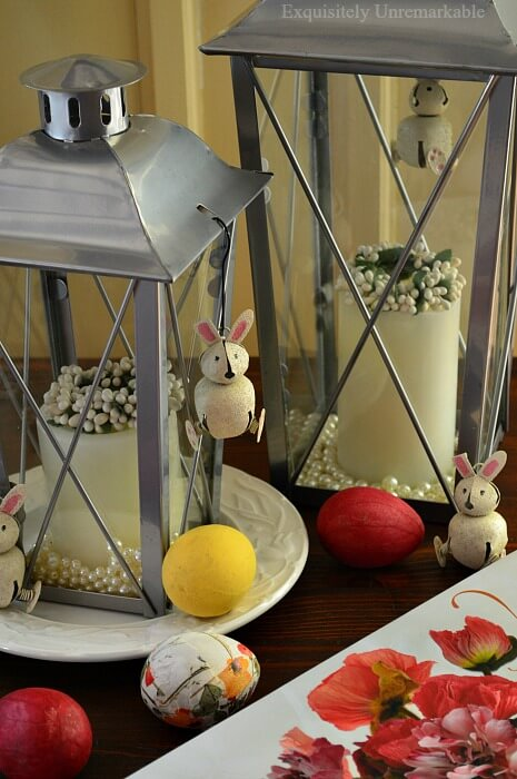 Metal Lanterns accessorized with mini wreaths, colored eggs and jingle bell bunnies for Easter
