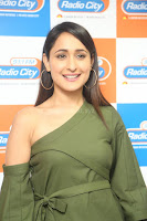 Pragya Jaiswal in a single Sleeves Off Shoulder Green Top Black Leggings promoting JJN Movie at Radio City 10.08.2017 123.JPG