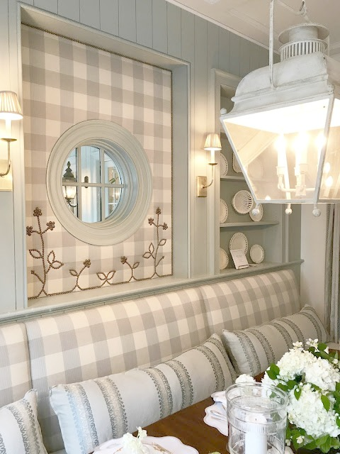 Blue and white check upolstered wall and banquette in traditional kitchen.