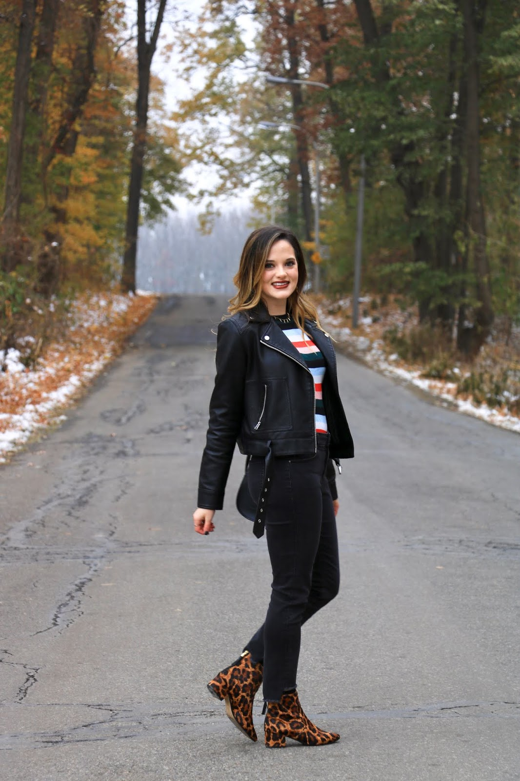Nyc fashion blogger Kathleen Harper wearing a black jeans outfit with a leather jacket.