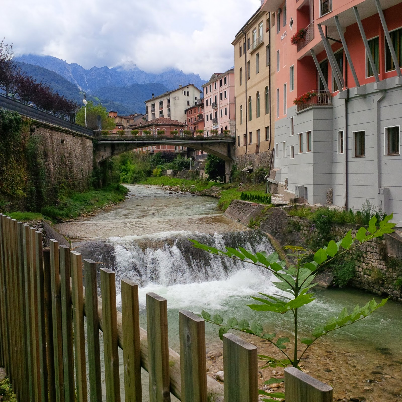 A wild stream passes by the playground in Recoaro Terme in Italy