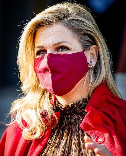 Queen Maxima wore a new leopard print dress from Natan. Diamond earrings and Natan red coat and pumps
