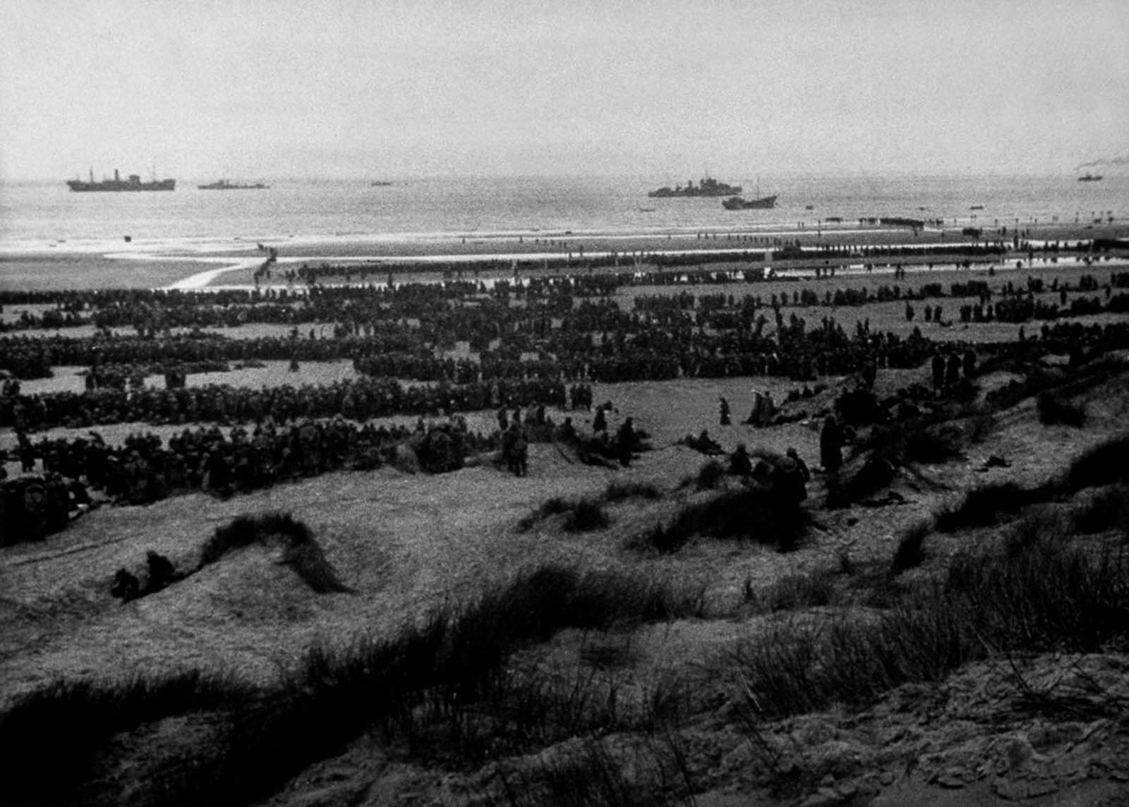 British Expeditionary Forces queue up on the beach at Dunkirk to await evacuation.
