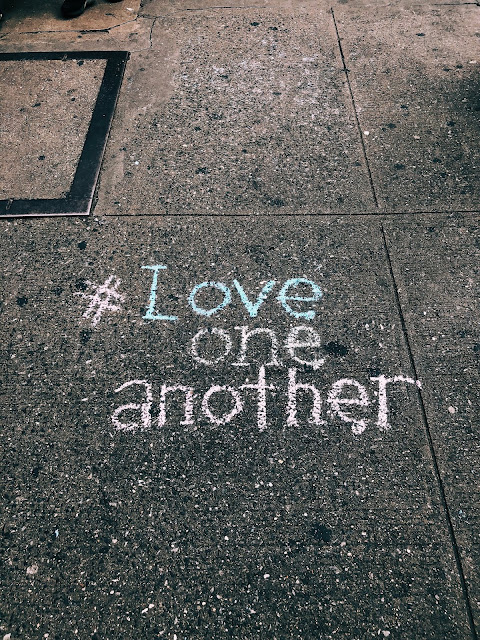 Pavement with love one and another written in chalk