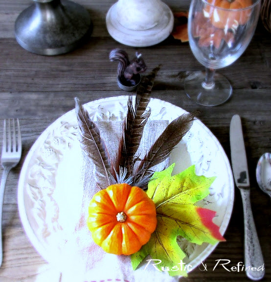 Pretty Fall Tablescape using pumpkins and feathers