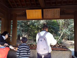 Cleansing ritual at Meiji Jingu Tokyo Japan
