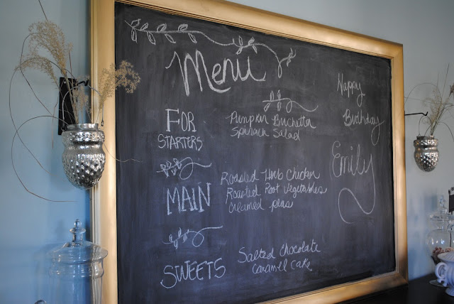 Gold framed chalkboard with menu