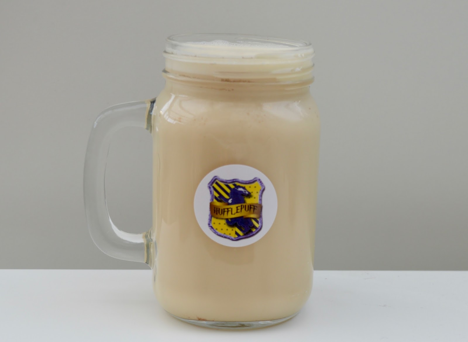 How to make Butterbeer in your Slow Cooker - a recipe with Yazoo flavoured milk - butterbeer in glass tankard
