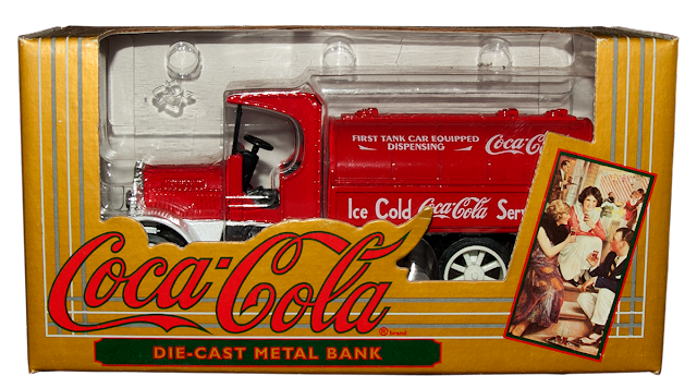 A collectible truck bank from Ertl with the Coca-Cola logo.