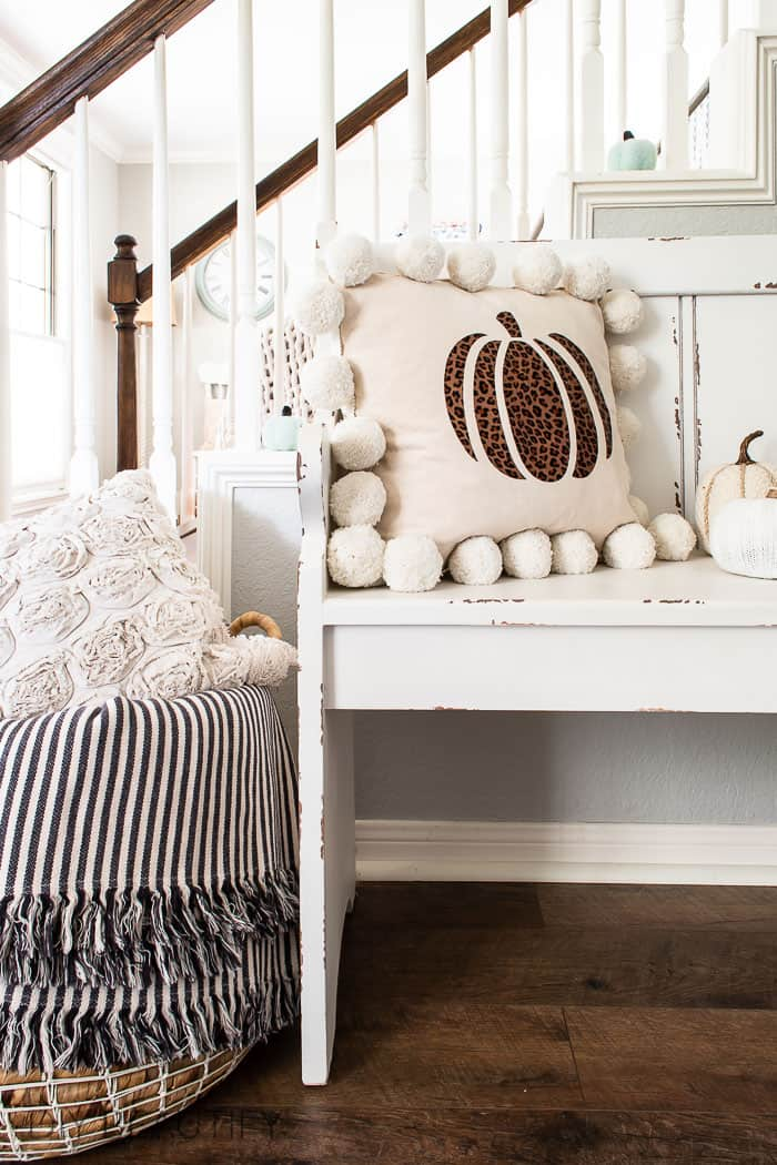 basket and bench with pillows