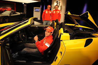 massa in Ferrari yellow super car