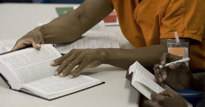 Inmate reading in prison