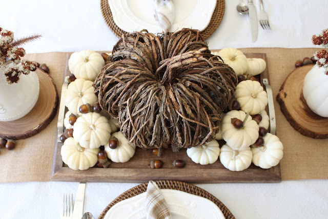 natural fall tablescape with willow pumpkin baby boos and acorns in creams and browns