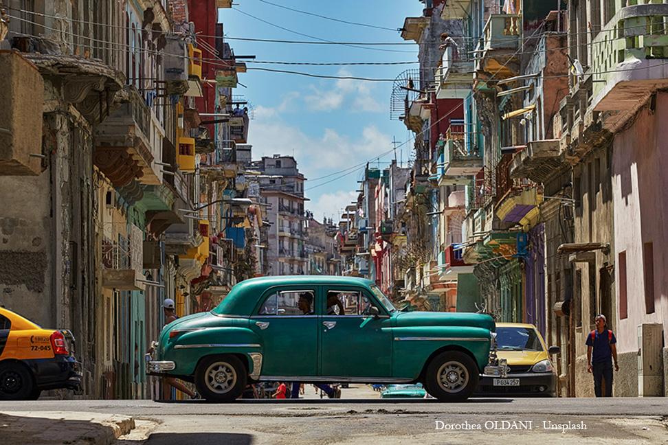 Green classic car in Havana