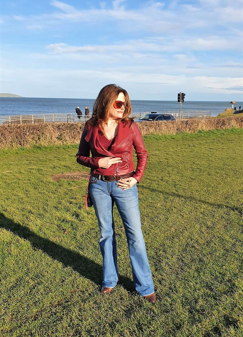 Irish blogger Hilda from Over the Hilda in faux leather jacket and flared jeans