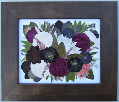 Deep reds and burgundy flowers in this floral preservation art