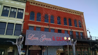 Vinyl sign on front of building: Lace, Grace & Gears