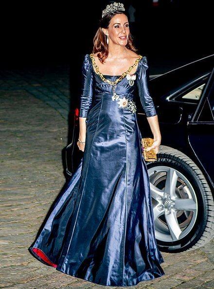Crown Prince Frederik, Prince Joachim, Princess Marie and Princess Benedikte. Crown Princess Mary wore Birgit Hallstein gown