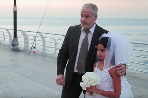 Passers-By React Angrily As Middle-Aged Man 'Marries 12-Year-Old Girl In Seaside Wedding'