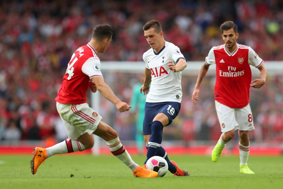 Arsenal's Granit Xhaka battles Tottenham's Giovani Lo Celso in midfield
