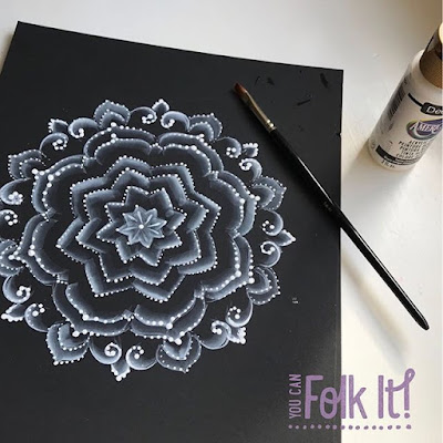 All white mandala created using floated colour and dots of paint