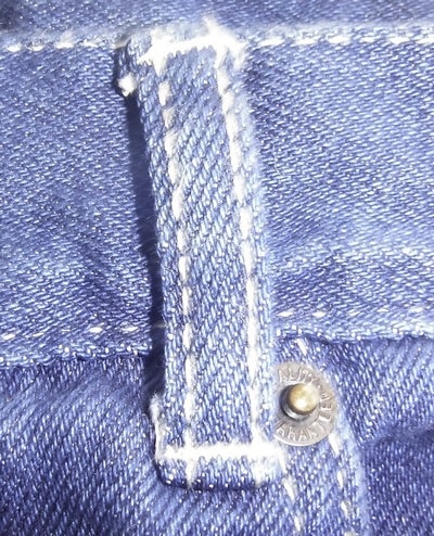 Belt loop attached to waistband and jeans body