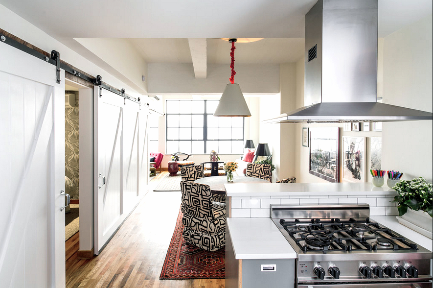 Anne Maxwellu0027s Colorful NYC Loft Apartmentu0027s Breakfast Nook With Moroccan  Rugs And Black And White Chairs