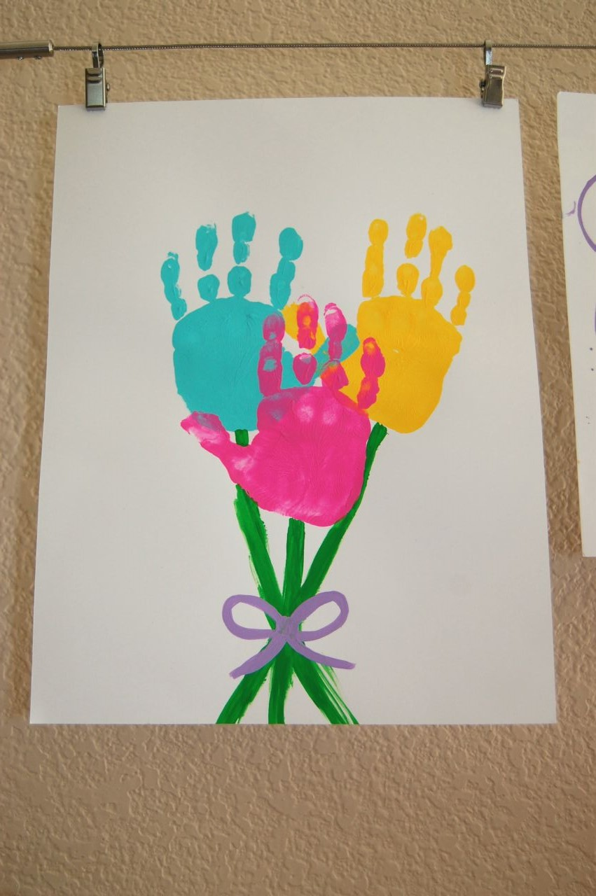 Kids easter art first we made this fun bouquet of hand print flowers it was simple do three hand prints then free hand paint the stems and bow izmirmasajfo