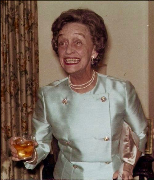 Snapshots of a fabulous older lady at a cocktail party wearing a satin jacket. c. 1960s. marchmatron.com
