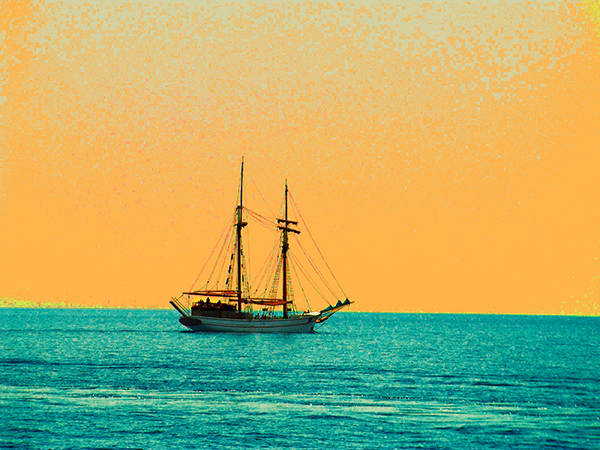 A sailboat at sea with unrealistic colors - turquoise sea and orange sky