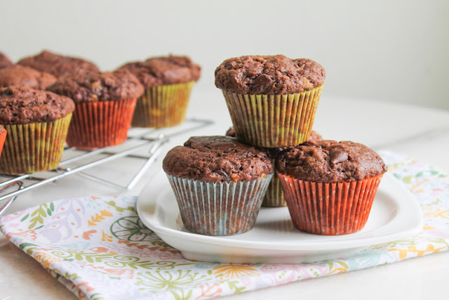 Food Lust People Love: The bananas are very subtle in these chocolate banana mini muffins. What they don't add in flavor though, they make up for in texture. These little guys are soft, tender and light. And oh, so chocolatey, with both cocoa and chocolate chips. Even if you aren't typically a fan of bananas, I encourage you to give these muffins a try.