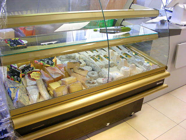 Cheese counter, Village corner shop, Indre et Loire, France. Photo by Loire Valley Time Travel.