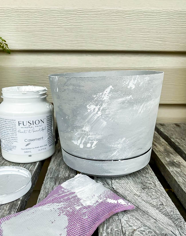 Apply white paint over gray paint