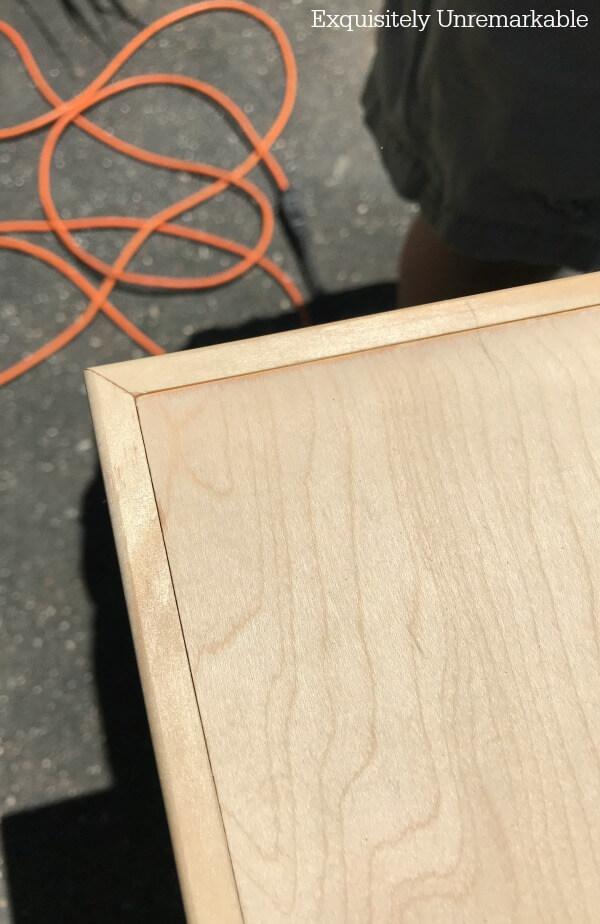 Unfinished wooden countertop with moulding added
