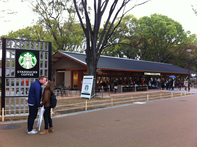 Ueno Park Tokyo, kissing in front of Starbucks.
