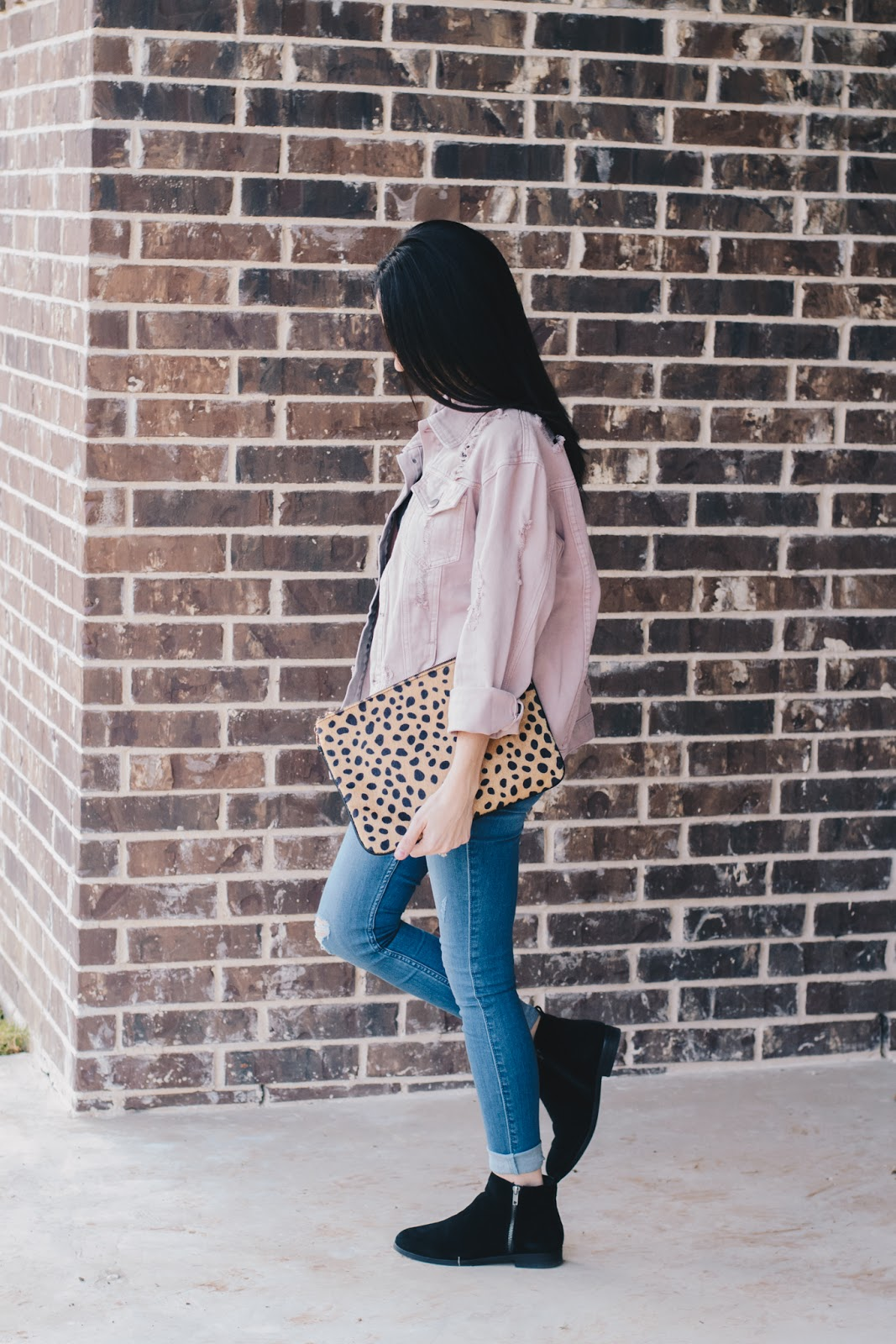 Throw on and go style in a distressed denim jacket and booties