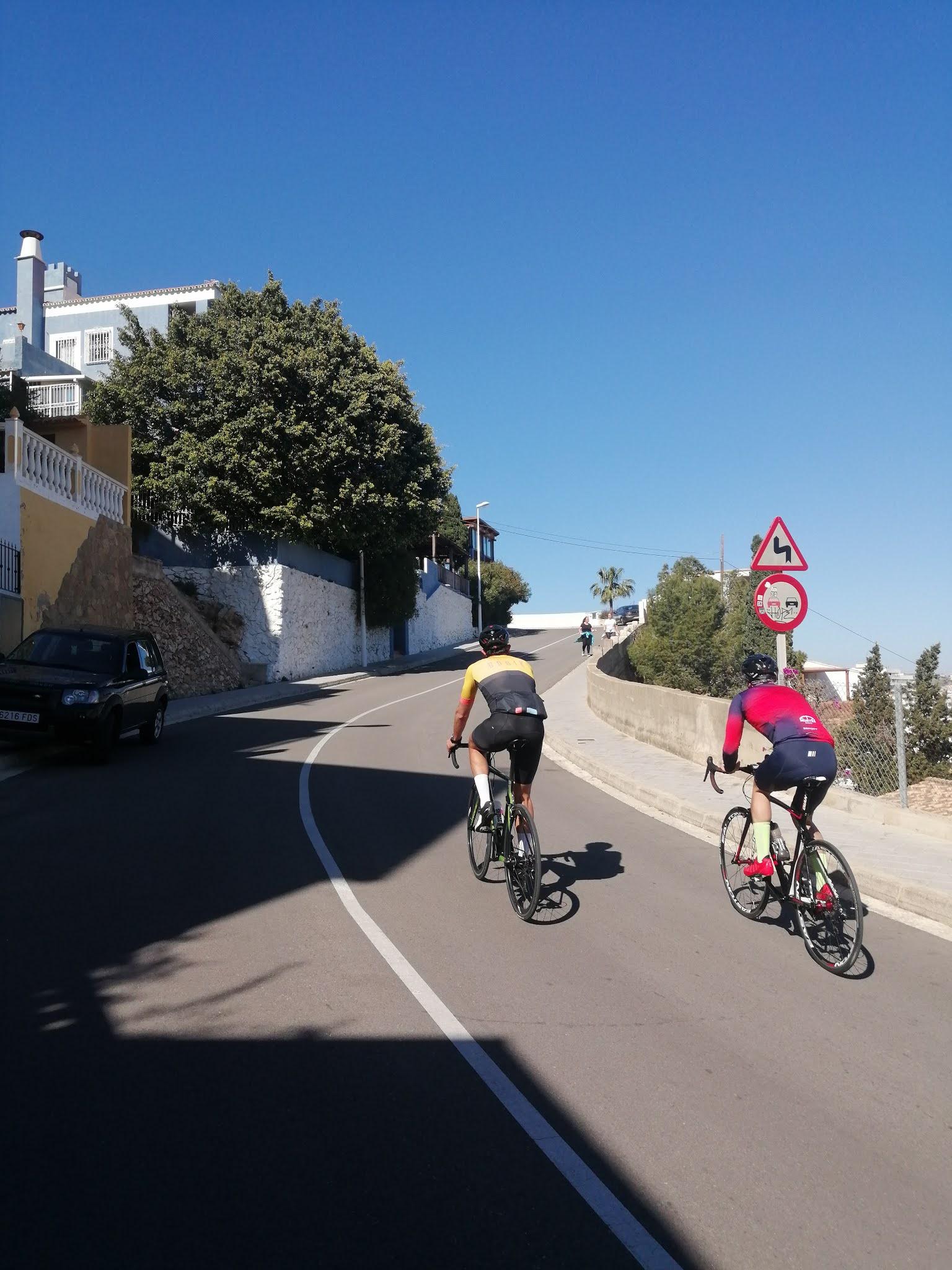 Cyclists on the climb to la Bola de Cullera, Valencia, Spain
