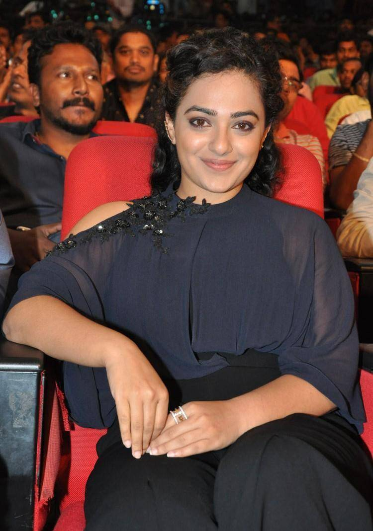 Actress Nithya Menon Stills At Movie Audio Launch In Blue Dress