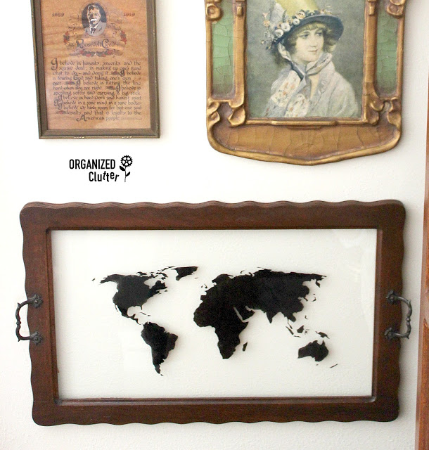Photo of vintage wood framed glass tray stenciled with world map
